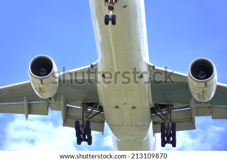 Takeoff, closeup bottom wing commercial airplane.  - stock photo