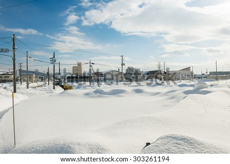 TAKIKAWA, JAPAN - JANUARY 10, 2015: Snow-covered parking lot of Takikawa Station.