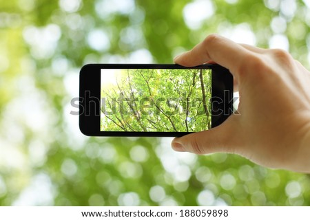 Taking a picture with a smart phone - stock photo