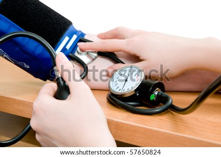 taking an arterial blood pressure by medical equipment tonometer
