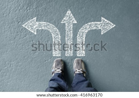 Taking decisions for the future man standing with three direction arrow choices, left, right or move forward - stock photo