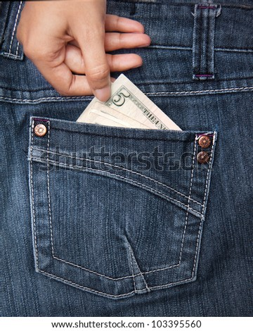 Taking money from jean pocket to spend