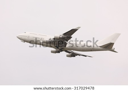Taking off of a commercial airliner - stock photo