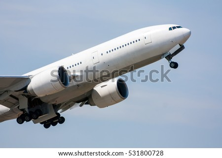 Taking off of the wide body passenger plane and retracting the landing gear