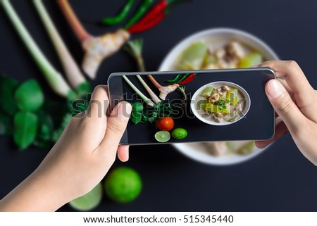 Taking photo of Chicken and coconut milk soup on black background