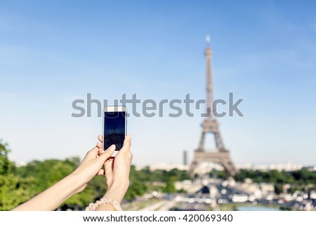 taking photo of Eiffel Tower