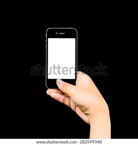 Taking photo with mobile phone on black, Hand holding mobile smart phone with blank screen. - stock photo