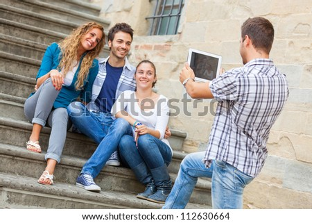 Taking Photos with Tablet PC - stock photo