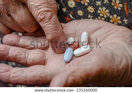 taking pill from palm - stock photo
