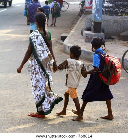 Taking the kids to school in India - stock photo