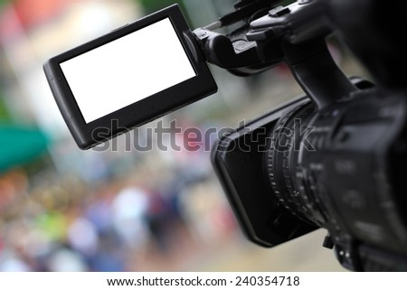 Taking video or footage using professional camera - isolated on white with blank camera screen. - stock photo