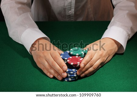 Taking win in poker on green table - stock photo