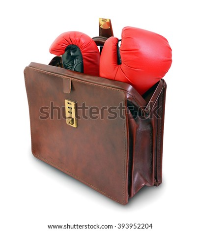 Taking your boxing gloves to the office/meeting or Career in boxing. Boxing gloves inside leather briefcase. Isolated on white. - stock photo