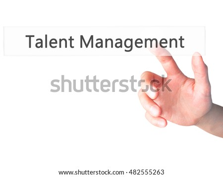 Talent Management - Hand pressing a button on blurred background concept . Business, technology, internet concept. Stock Photo