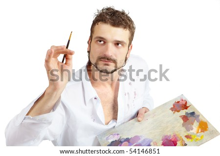 Talented artist with brush and palette in action. Isolated over white - stock photo