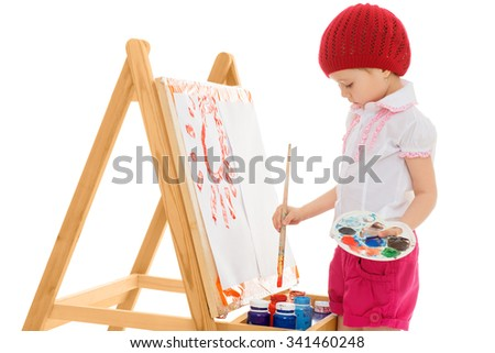 Talented girl artist stands at his easel and draws a picture paints . The plan-Isolated on white background - stock photo