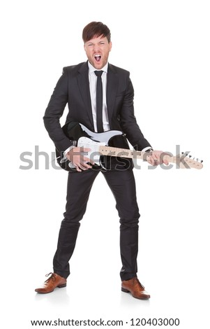 Talented guy wore black coat and tie when singing. - stock photo