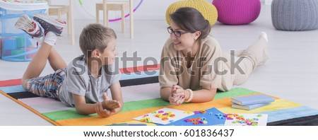 Talk between female therapist and young boy