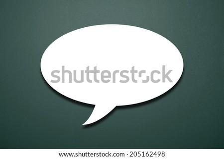 Talk Bubble On Blackboard - stock photo