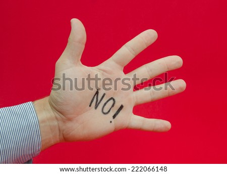 Talk to the hand or saying no to something suggested by a business man's hand with no written on it on a red alerted background - stock photo