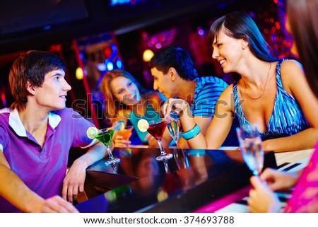 Talking at bar counter - stock photo