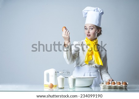 Talking cook in white kitchen cooking pie - stock photo