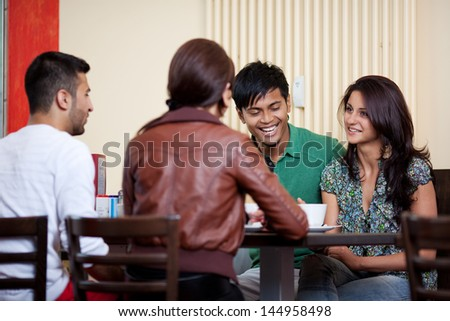 Talking in a coffee shop between good friends - stock photo