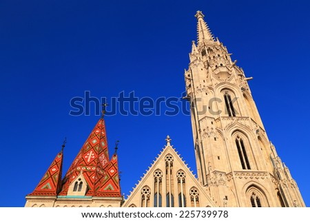 Tall and colorful roof and tower of St Matthias catholic church in Budapest, Hungary - stock photo