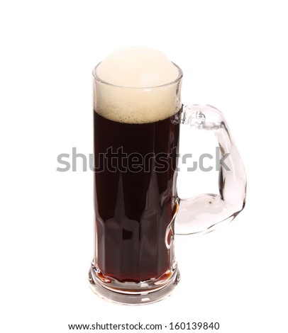 Tall big mug of beer with foam. Isolated on a white background.