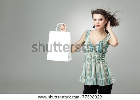 tall brunette woman shopping white bag wind - stock photo