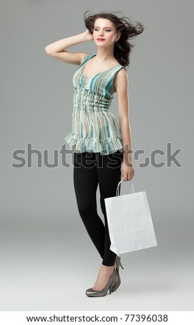 tall brunette woman shopping white bag wind - stock photo