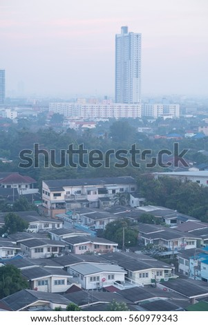 tall building and village