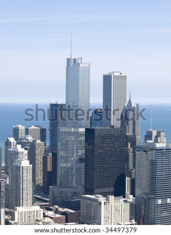 tall buildings from the air Chicago with lake in background