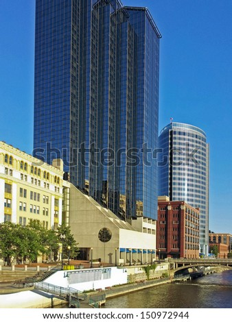 tall buildings on the Grand River in Grand Rapids, Michigan - stock photo