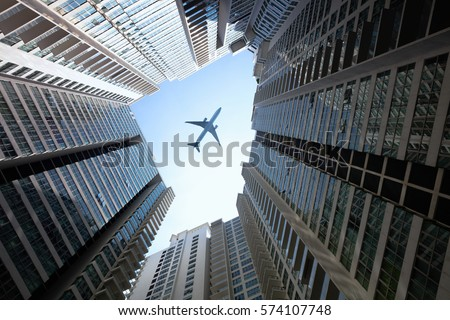 Tall City Buildings Plane Flying Overhead Stock Photo 271576763