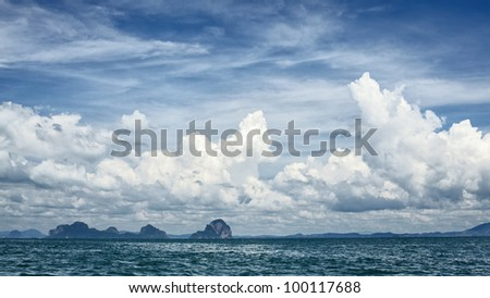 tall cliff with trees at Andaman Sea, Thailand - stock photo