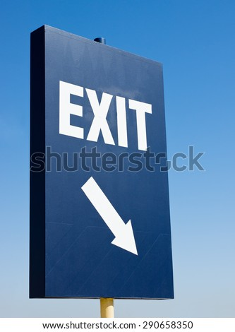 Tall exit sign with arrow - stock photo