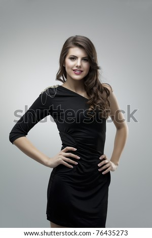 tall girl black dress pose glamorous - stock photo