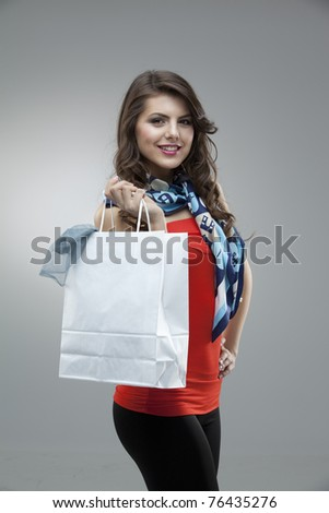 tall girl fashion posing red blouse bag - stock photo