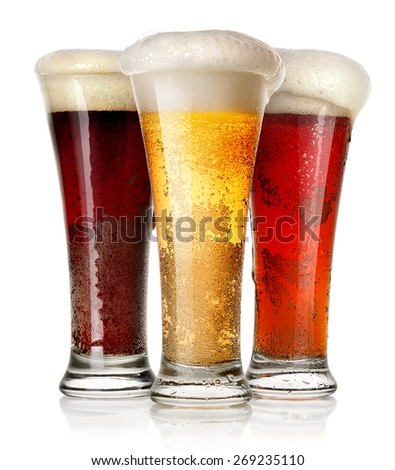 Tall glasses of beer isolated on a white background - stock photo