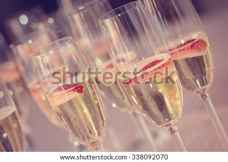 Tall glasses with sparkling wine and strawberries