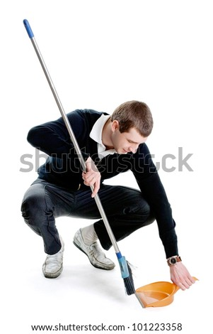 Tall man sweeping a room. Isolated on white.