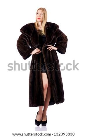 Tall model wearing fur coat - stock photo