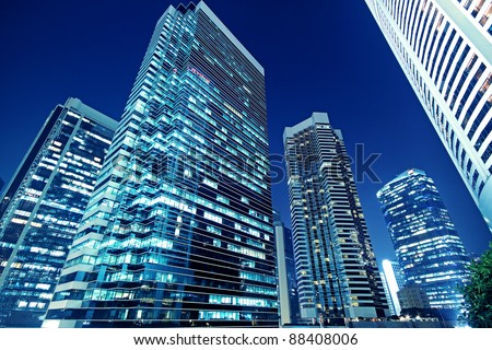 Tall office buildings by night - stock photo
