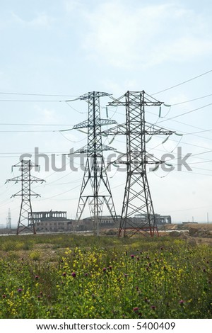 Tall power lines during bright summer day
