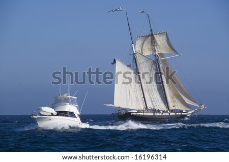 Tall Ship and Modern Boat