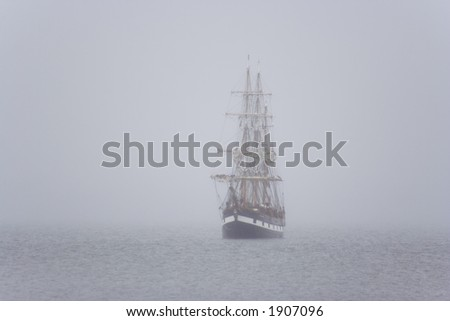 Tall ship in the morning mist - stock photo