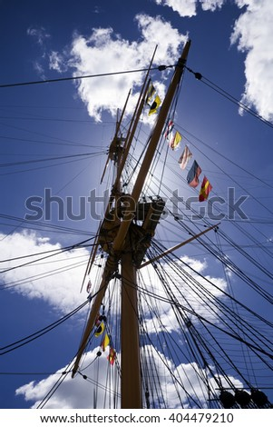 Tall Ship rigging; mast with ropes and signal flags  - stock photo