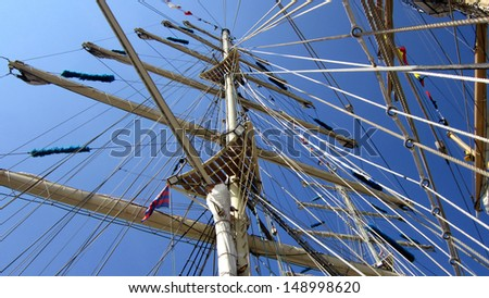 Tall ships masts with rigging - stock photo