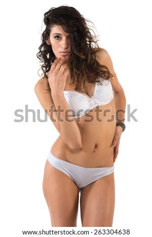 Tall slender brunette dressed in white lingerie - stock photo